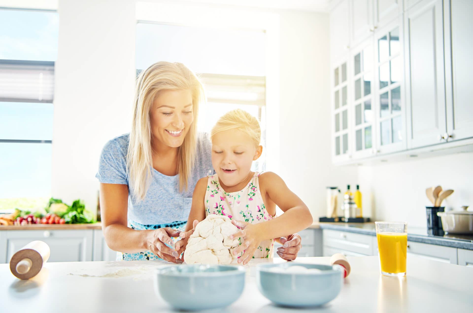 mother and daughter in kitchen updwell homes utah home builder
